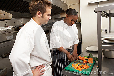 Chef Instructing Trainee