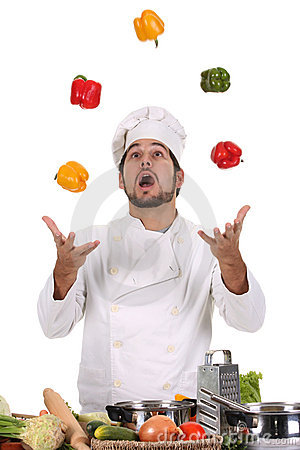Free Chef Juggling With Peppers Royalty Free Stock Photography - 6967287