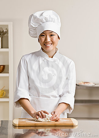 Free Chef Kneading Dough In Commercial Kitchen Royalty Free Stock Image - 6581906