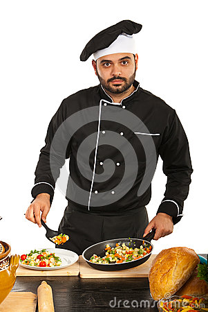 Chef man decorate food on plate