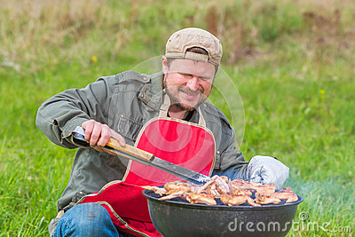 Chef man preparing barbecue roasted meat on the Stock Photo