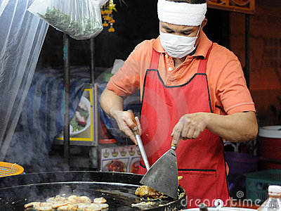 Chef at a Roadside Kitchen in Bangkok Editorial Stock Image