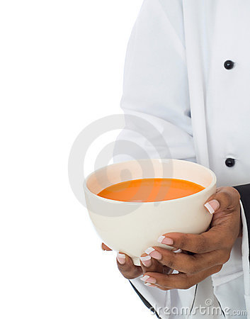 Chef serving soup