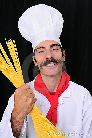 Chef smiling and holding spaghetti
