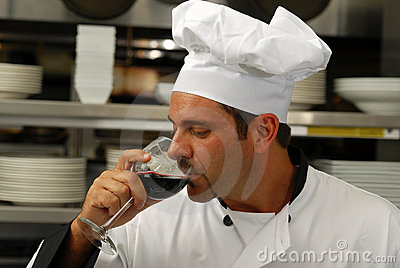 Chef tasting a glass of wine
