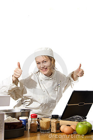 Chef using computer with thumbs up