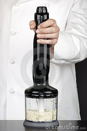Chef Using Hand Blender To Make Bread Crumbs