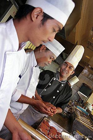 Free Chef Working In The Kitchen Royalty Free Stock Photography - 9562247