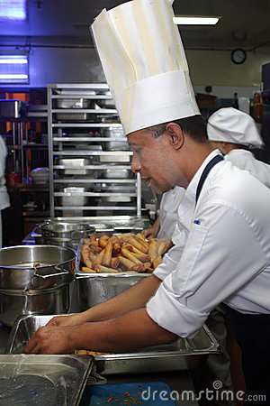 Free Chef Working In The Kitchen Royalty Free Stock Photo - 9631125