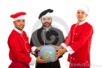 Chefs team holding world globe