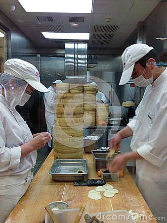 Chefs at work in a Chinese restaurant kitchen