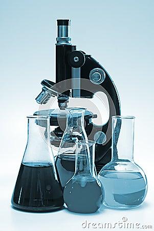 Chemical laboratory glassware and microscope