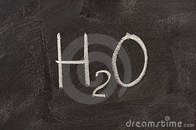 Chemical symbol of water on blackboard