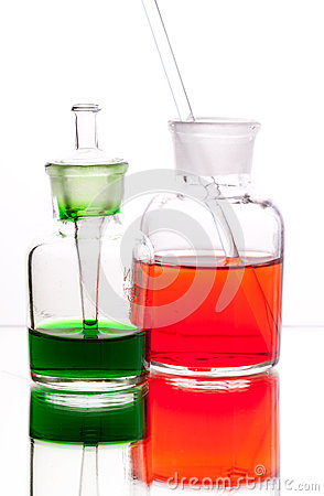 Chemistry laboratory glassware with colour liquids on white back
