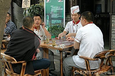 Chengdu, China: Chefs Playing Cards Editorial Photo