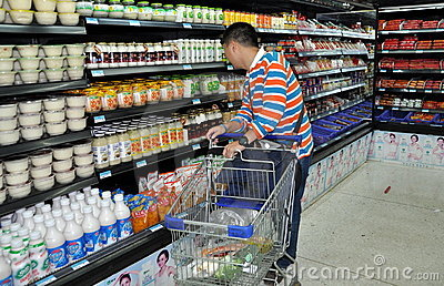 Chengdu, China: Man Shopping in Supermarket Editorial Photography