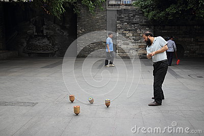 Chengdu, China: Man Spinning Top