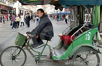Chengdu, China: Pedicab Taxi Driver Editorial Stock Image