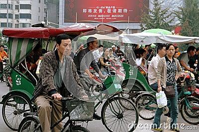Chengdu, China: Pedicabs at Traffic Light Editorial Photo