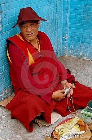 Chengdu, China: Seated Tibetan Monk Editorial Stock Image