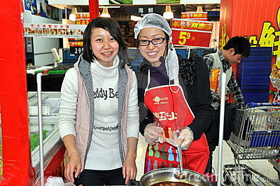 Chengdu, China: Young Workers at Wal-Mart Editorial Stock Photo