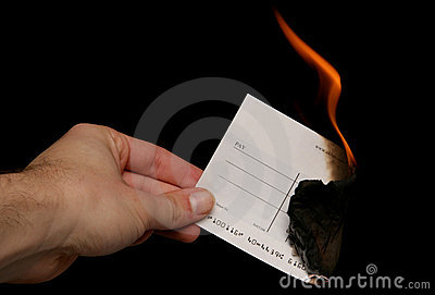 Cheque being burnt cutout