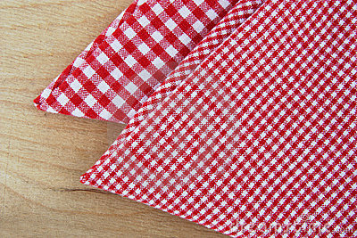 Chequered napkins on wooden table