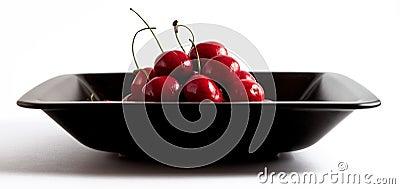 Cherries in black bowl