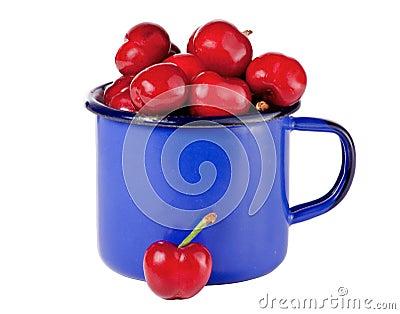 Cherries in a blue mug