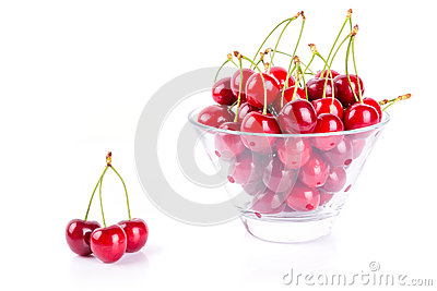 Cherries in the bowl over white