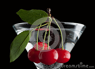 Cherries in a martini glass.