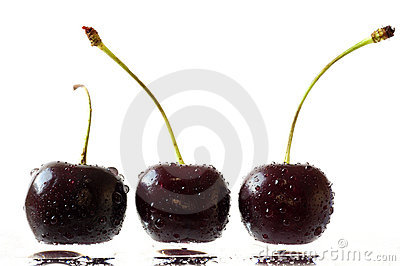 Cherries on a wet surface