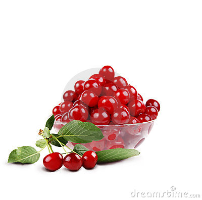 Cherry in the bowl with sprig of cherry