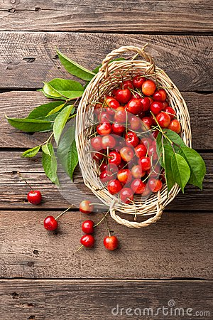 Free Cherry. Fresh Sweet Cherry With Leaves In Basket On Wooden Table Royalty Free Stock Photography - 114881297