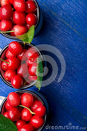 Free Cherry In Enamel Cup On Blue Wooden Background. Healthy, Summer Fruit. Cherries. Top View. Copy Space. Stock Photo - 94294900