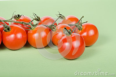 Cherry tomatoes attached on green vines