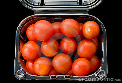 Cherry tomatoes isolated on black background