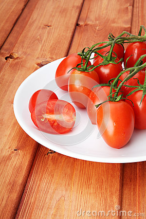 Cherry tomatoes on white plate
