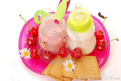 Cherry yogurt and bottle of milk for baby
