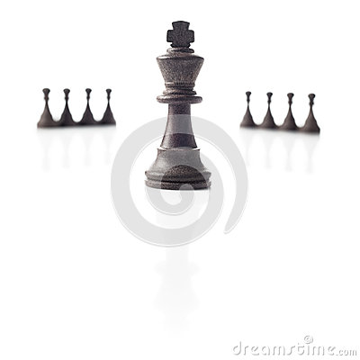 Chess. Black king and pawns. Power concept.