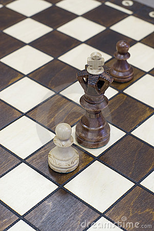 Chess piece figure standing on chess board