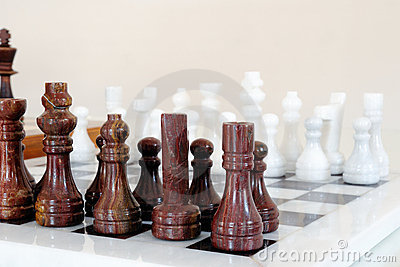 Chess pieces on ceramic board