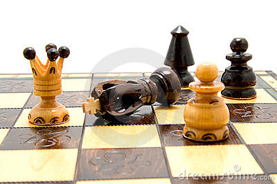 Chess pieces on chess-board with fallen king