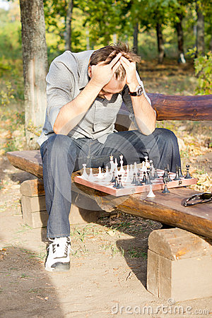 Chess player in despair