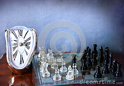 Chessboard game and Dali-like clock