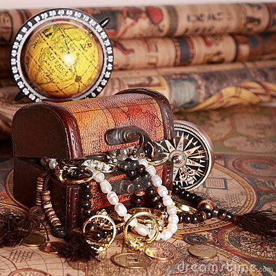 Chest, compass, globe on antique map