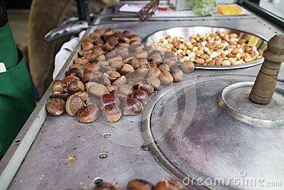 Chestnuts roasting on sidewalk cart