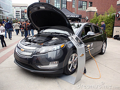 Chevy Volt on display at ballpark with hood open Editorial Image