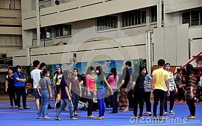 Chiang Mai, TH: Teens in School Yard Editorial Photo