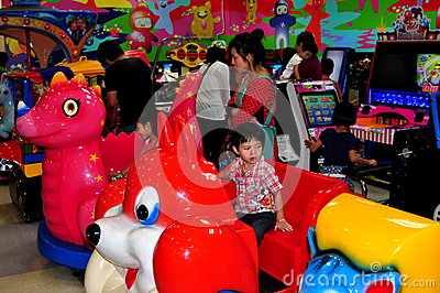 Chiang Mai, Thailand: Child at Store Play Area Editorial Photography